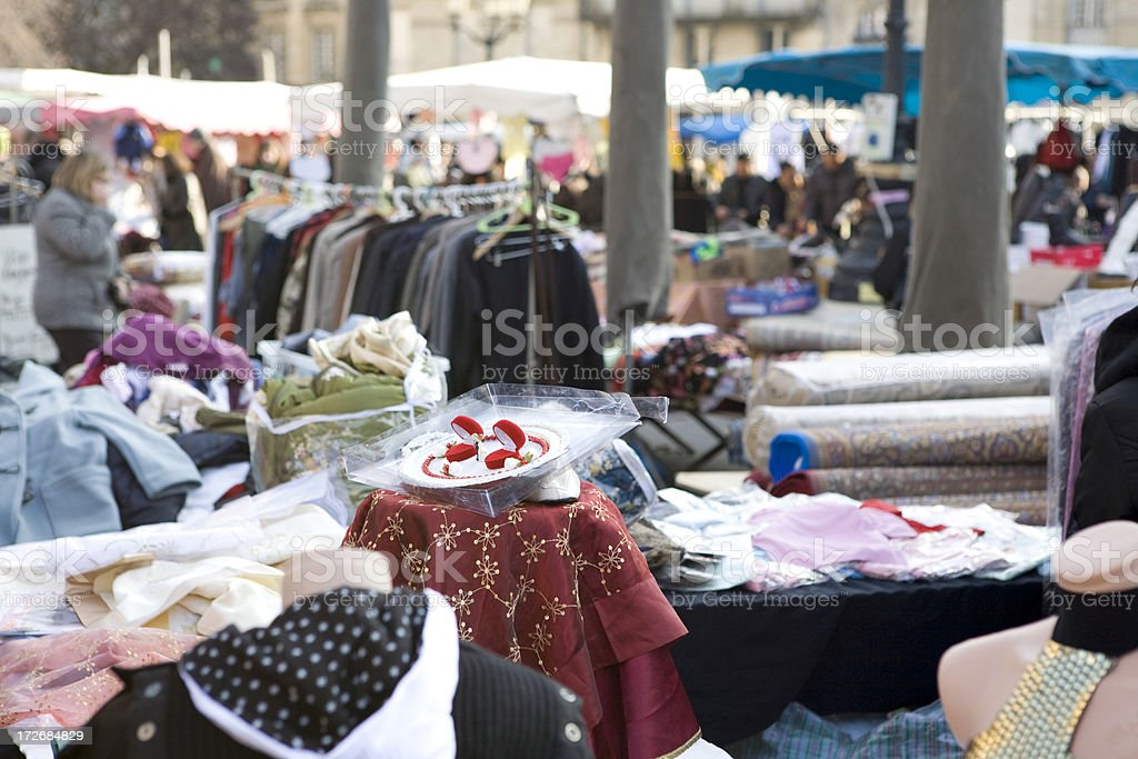 Bolts of fabric at a weekend flea market, Bordeaux, France royalty-free stock photo