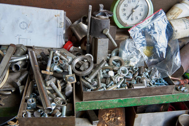 Bolts, washers, nuts and metal products are scattered on the workshop's desk Bolts, washers, nuts and metal products are scattered on the workshop's desk washer fastener stock pictures, royalty-free photos & images