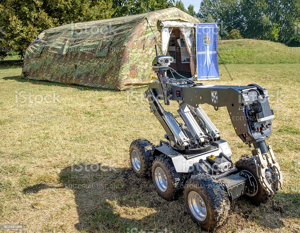 Bomb disposal robot green military curtain stock photo