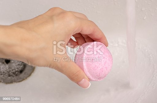 656780900istockphoto Bomb for bath in the hands of the bathroom water 996970484