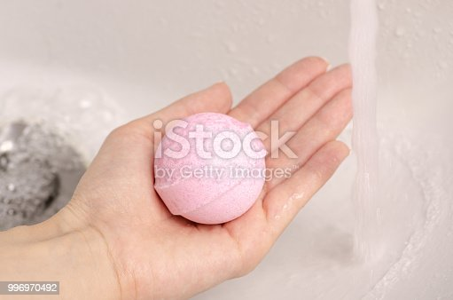 656780900istockphoto Bomb for bath in the hands of the bathroom water 996970492