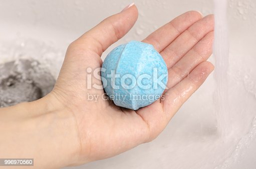 656780900istockphoto Bomb for bath in the hands of the bathroom water 996970560