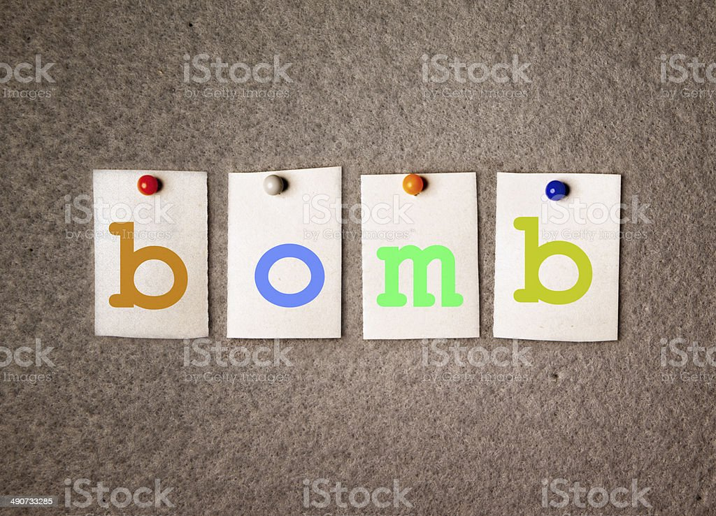 bomb note on pin board royalty-free stock photo