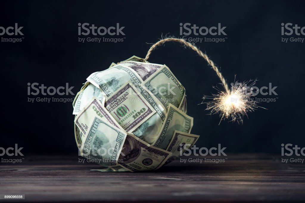 Bomb of money hundred dollar bills with a burning wick. Little time before the explosion. Concept of financial crisis stock photo