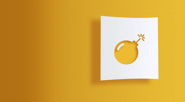 bomb on white information paper on yellow background stock photo
