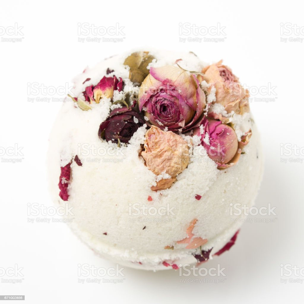 Bomb salt bath decorated with dried roses stock photo