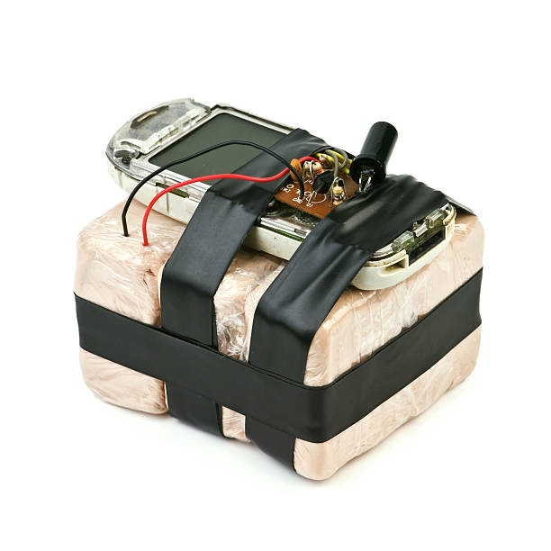 Bomb strapped to a detonator on a white background homemade bomb with mobile phone isolated explosive stock pictures, royalty-free photos & images