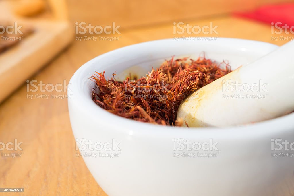 Bombax ceiba dried flowers in white bowl on the table. stock photo