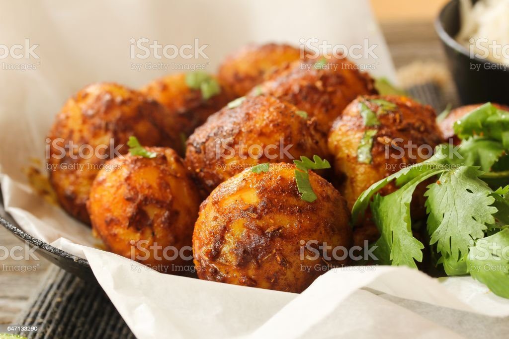 Bombay potatoes - popular indian side dish, selective focus stock photo