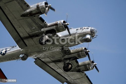B-17 bomber with gear down for landing.
