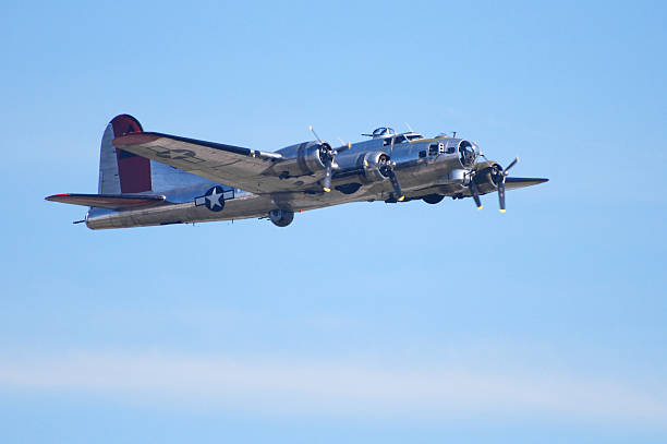 WWII bomber airplane B17 Flying Fortress flying in blue sky World War II bomber. B-17 Flying Fortress. bomber plane stock pictures, royalty-free photos & images