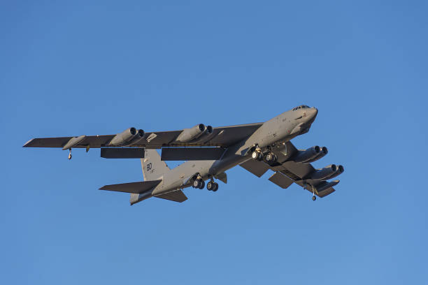 B-52 Bomber approaches Barksdale AFB Bossier City, LA, U.S.A. – Jan. 24, 2017: A U.S. Air Force B 52 bomber, assigned to the Air Force Global Strike Command's Eighth Air Force, flies over Bossier City toward Barksdale Air Force Base. bomber plane stock pictures, royalty-free photos & images