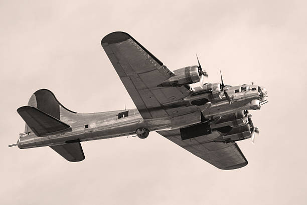 WWII bomber B17 Fortress flying World War II bomber. Bomb bay doors open. B-17 Flying Fortress. bomber plane stock pictures, royalty-free photos & images