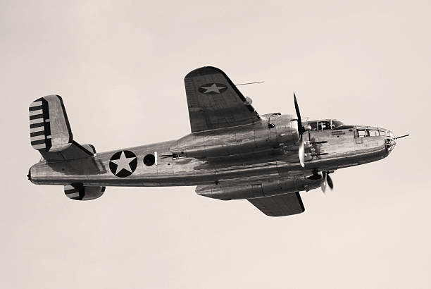 wwii bomber b25 mitchell flying - world war ii stock photos and pictures