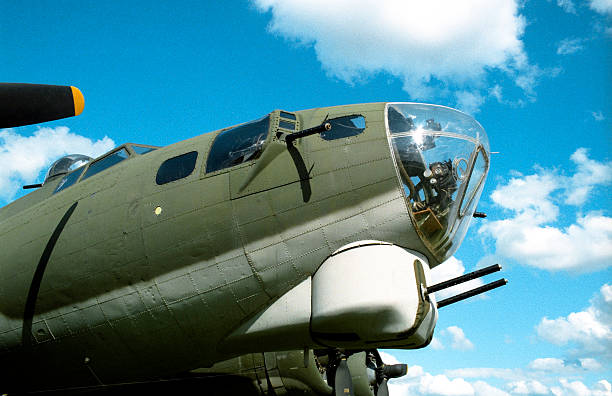B17 Bomber A close view of the nose of a B17 Flying Fortress WWII bomber bomber plane stock pictures, royalty-free photos & images