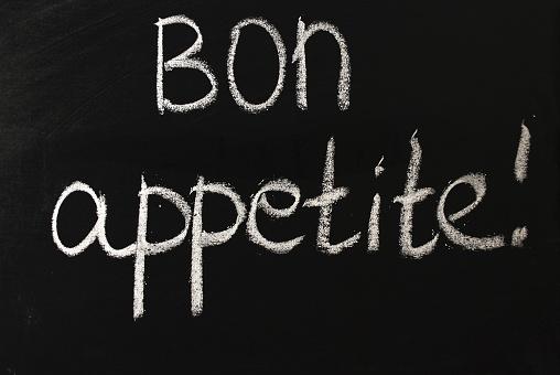 istock Bon appetit word written in white chalk on a black chalkboard 1206635206