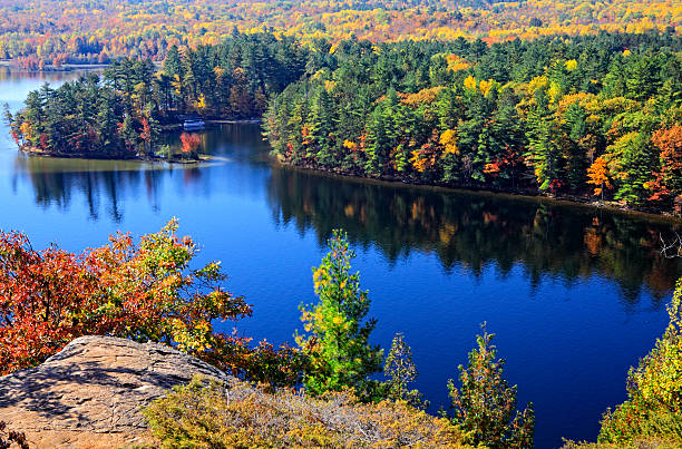 bon echo fall color and lake - provincial park stock photos and pictures