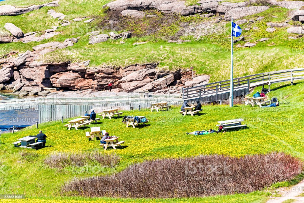 Bonaventure Island Park entrance in Gaspe Peninsula, Quebec, Gaspesie region with people sitting at picnic tables stock photo