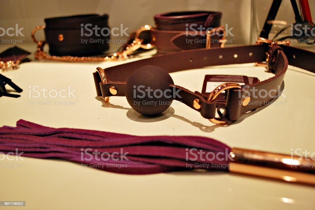 Bondage sadomasochism sex games erotic handcuffs and leather bdsm dominance whip stock photo
