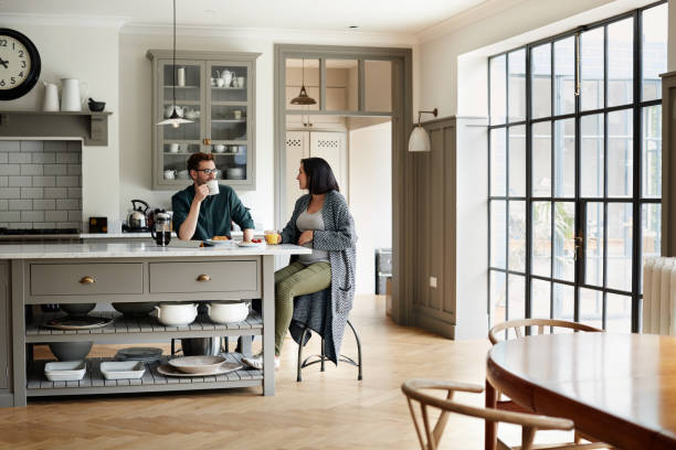 bonding around the breakfast table - modern lifestyle stock photos and pictures