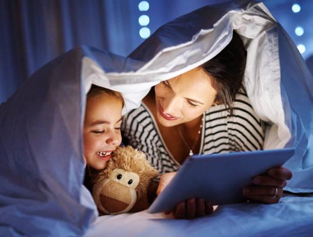 Bonding at bedtime stock photo