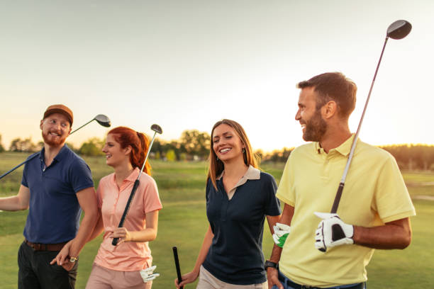 bonding on the golf course - golf stock photos and pictures
