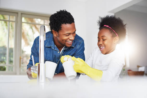 Bonding over dirty dishes stock photo