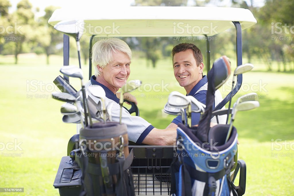 Bonding together on the golf course stock photo