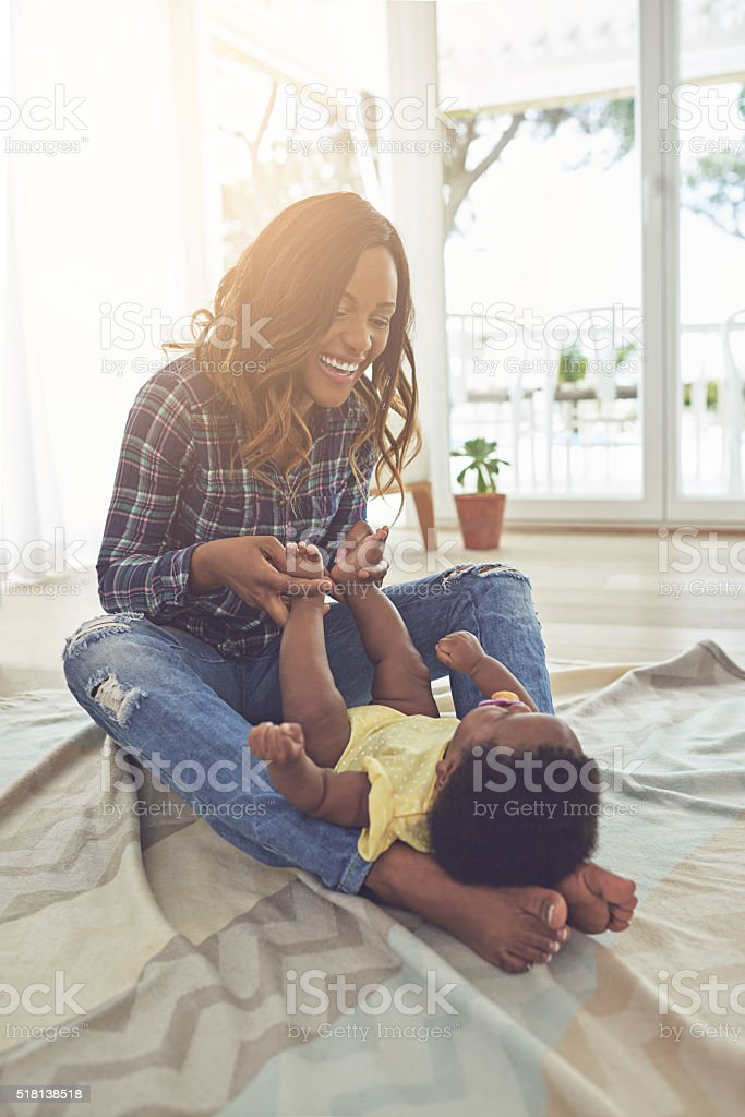Bonding with her baby stock photo