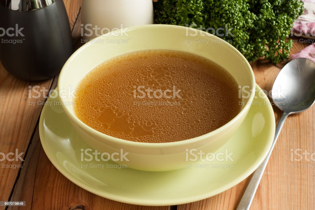 Bone broth made from beef stock photo
