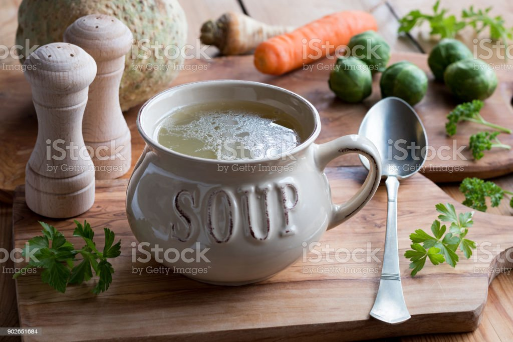 Bone broth made from chicken in a soup bowl stock photo