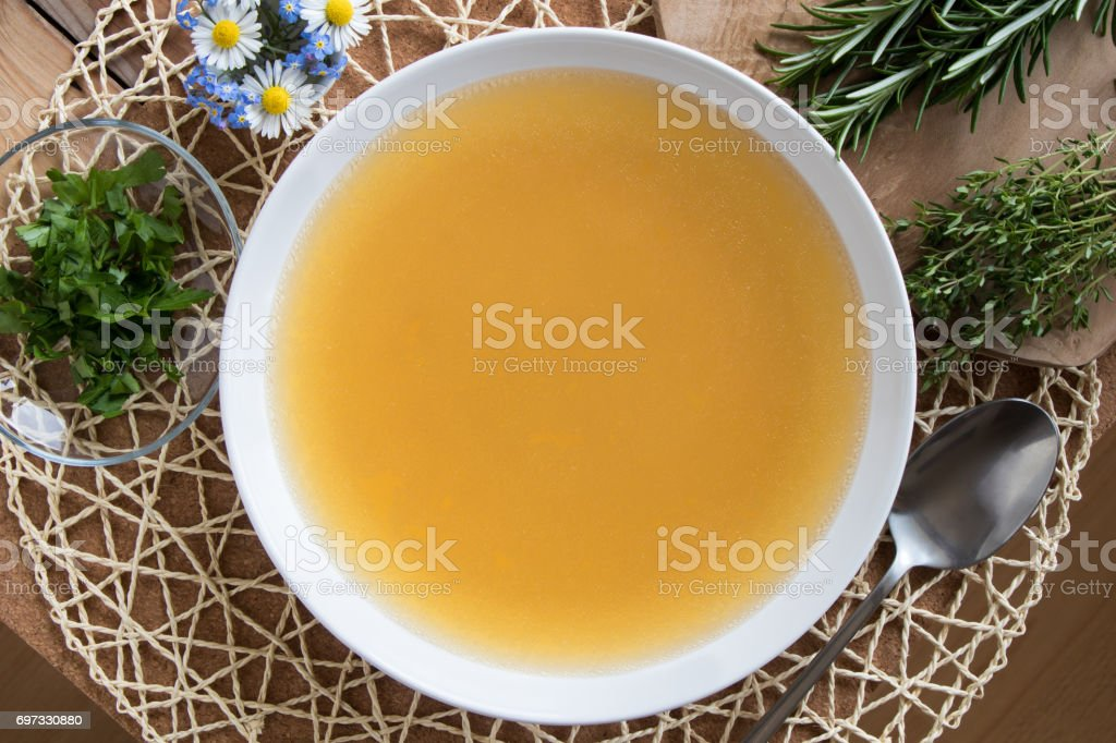 Bone broth made from chicken stock photo