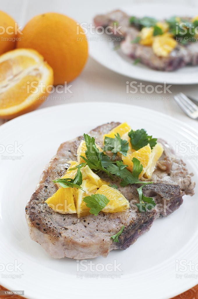 Bone in pork with oranges and cilantro royalty-free stock photo