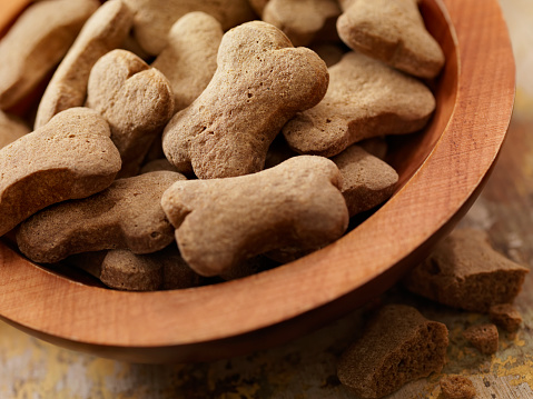 Bone Shaped Dog Treats in a Wooden Bowl -Photographed on Hasselblad H3D-39mb Camera