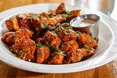 istock Boneless buffalo wings with sauce in bowl 1223001889