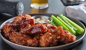 istock boneless chicken wings covered in honey garlic bbq sauce with ranch and celery 1250528991