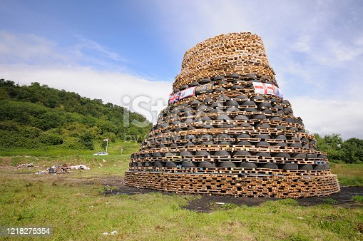 Bonfire at made from wooden shipping pallets to celebrate the 12th July commemoration of the Battle of the Boyne, (1690), Northern Ireland.