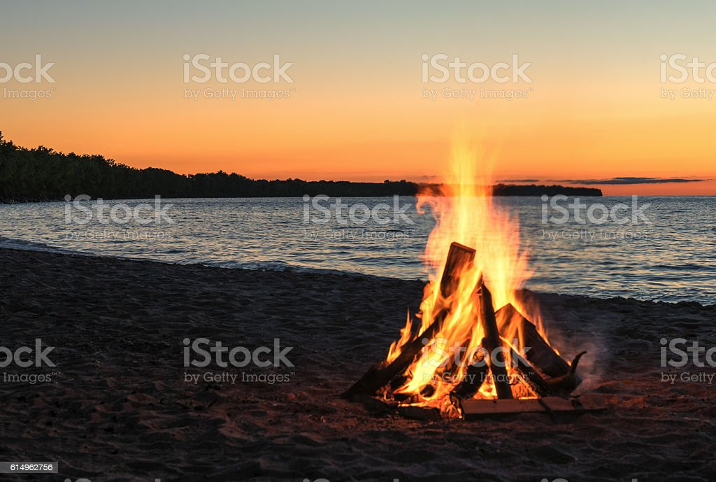 Bonfire at the Beach with Beautiful Sunset stock photo