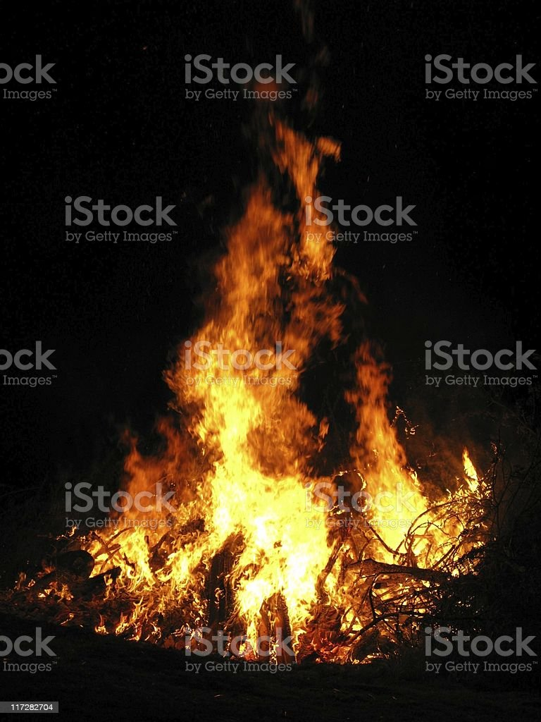 Bonfire burning in the night with flames leaping stock photo