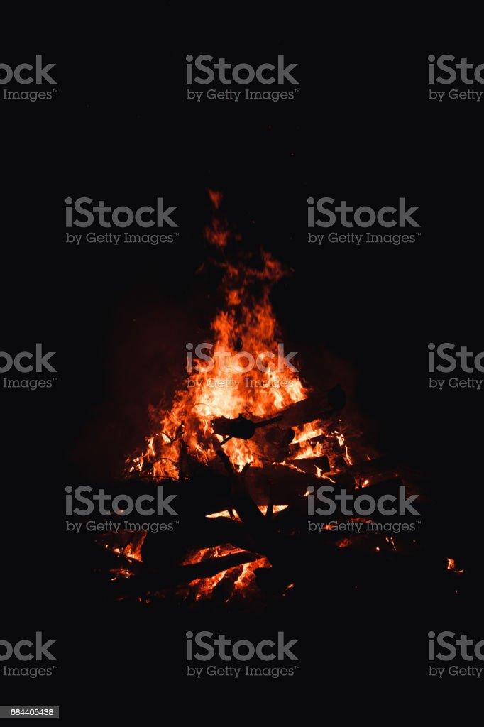 Bonfire burning trees at night. Bonfire burning brightly, heat, light,camping, big bonfire. stock photo