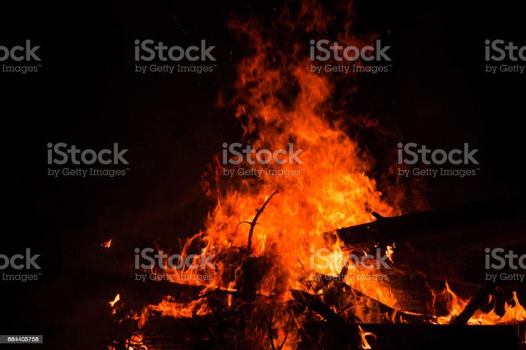 Bonfire burning trees at night. Bonfire burning brightly, heat, light,camping, big bonfire. close up stock photo