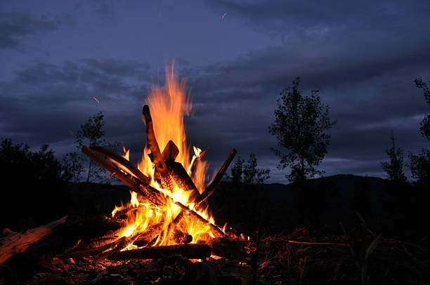 Bonfire, campfire campfire at sunset bonfire stock pictures, royalty-free photos & images
