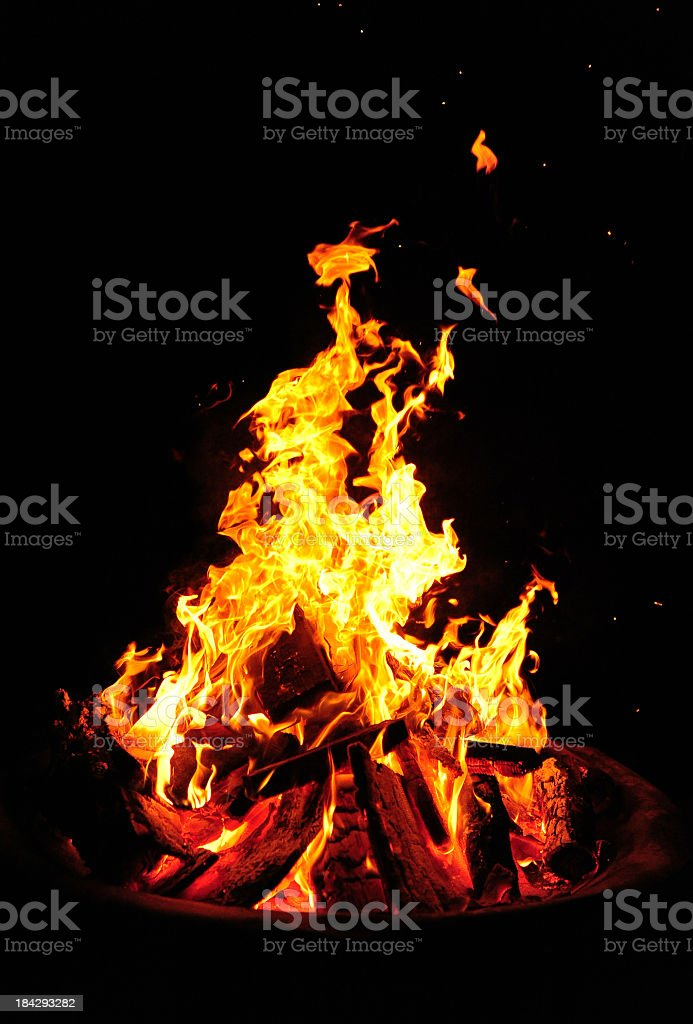 A bonfire in flames on a dark background royalty-free stock photo