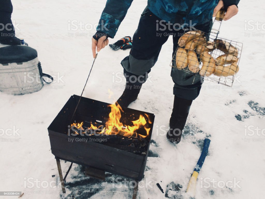bonfire in the grill in winter stock photo