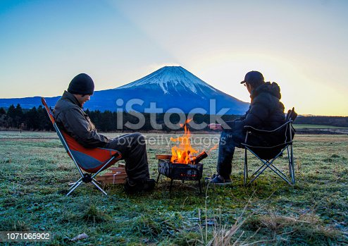 Warm up with a bonfire inthe morning. Camping at  the foot of Mt.Fuji.