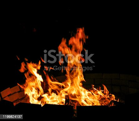 bonfire and embers on black background