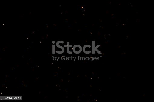 istock bonfire spark in the dark sky in night, shallow focus 1034310764