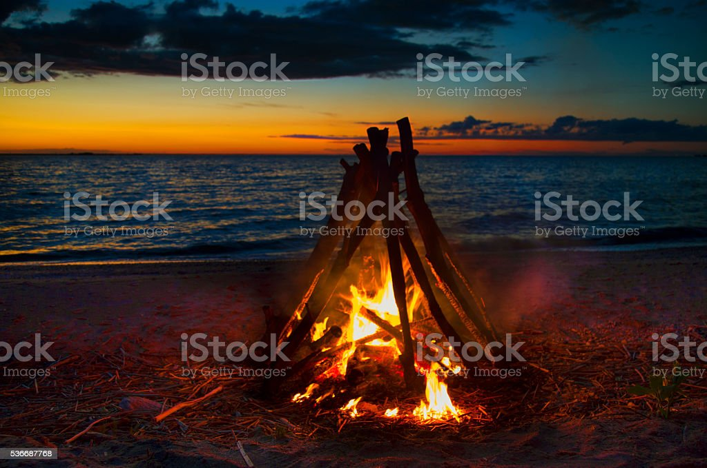 Bonfire tripod by the beach stock photo