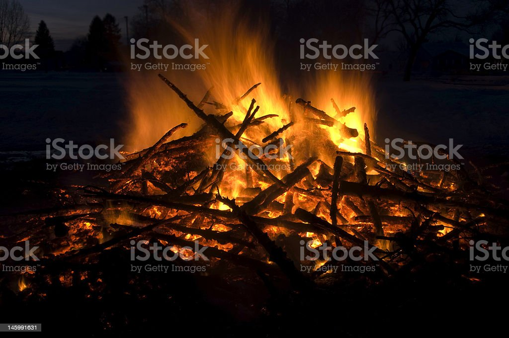Bonfire with flames leaping off a pile of trees royalty-free stock photo