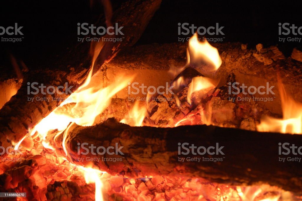 Bonfire with sparks flying around. Flame amd fire sparks on dark...